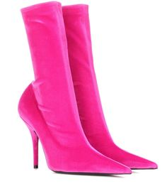 Balenciaga - Knife velvet ankle boots - Balenciaga's Knife ankle boots have a sharp silhouette and stretchy sock-like fit inspired by the universe of fetishism. Crafted in Italy from plush velvet, this bright fuchsia pair have a keen knife-inspired pointed toe and an ice-pick heel. Work yours with second-skin separates for a sultry ensemble. seen @ www.mytheresa.com