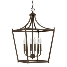 this 6light foyer pendant features a painted burnished bronze finish that will complement