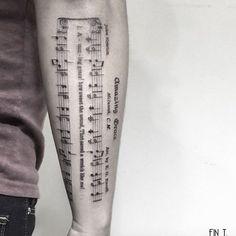 Sheet music tattoo by Fin Tattoos #TattooYou