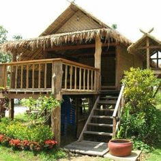"Here are 50 photos of houses made of logs or wood, bamboo, and other indigenous materials. From small and simple ""Bahay Kubo"" to rustic cabins and. Thai House, Bamboo House Design, Tiny House Design, Rest House, House In The Woods, Bahay Kubo Design, Jungle House, Bamboo Architecture, House On Stilts"