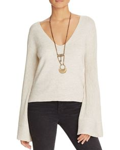Featuring gracefully-flared sleeves and allover ottoman ribbing, this ivory knit from Free People is simultaneously relaxed, refined and resplendent with denim. | Nylon/modal/wool | Hand wash | Import