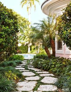 Stone path to pool - Designer Robin and Bill Weiss' Palm Beach vacation home, via Traditional Home.