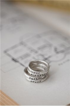 stacking rings - 4 rings {sterling silver} - with my kid's names. <3