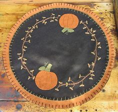 "14"" round candle mat by socr923 (ebay)   $22.95 + shipping"
