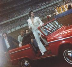 Houston Astrodome - Joe Esposito holds on to Elvis' belt as they ride around the the perimeter of the Astrodome before going onto the rotating stage in the middle of the arena.