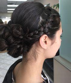 Side braid into a classical bun.