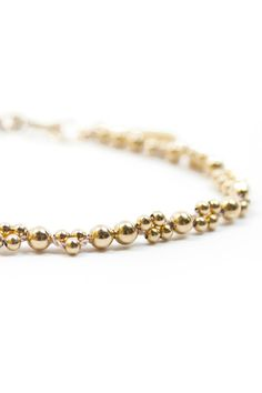 Shiny, gold and delicate - this bracelet while stand out on it's own or look amazing stacked with a few others! www.mooreaseal.com