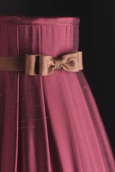 #Downton - hand pleated in ruby silk dupion with juniper hand formed bow trim