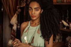 Stunning!! Her natural hair is in loose 2-strand twist.