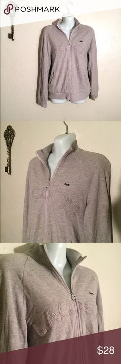 Authentic Lacoste zipper up AUTHENTIC LACOSTE great in gray! Pockets on each side in front! There is a small stain on the front as shown in last photo barely noticeable Lacoste Jackets & Coats