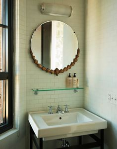 small bathroom - subway tile backsplash; simple but large mirror; vintage overhead light fixture; minimalist glass shelf; pedestal (?) sink with built-in towel bar there.  these elements are just what we need!