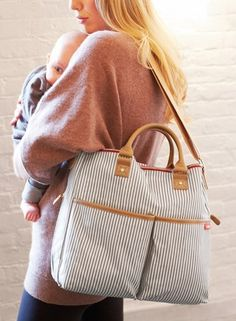 Love the grey & white stripes matched with tan detailing on this diaper bag.