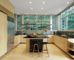 Lakeside House by Resolution: 4 Architecture, sustainable kitchen with big windows and plenty of storage