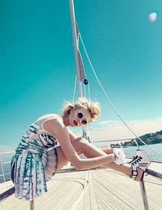 I think the colors in this picture are great, the boat, the sky and the sea and the girl's hair.   Those sunglasses are very cool!