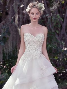 Maggie Sottero - KATHERINE, Romantic and sophisticated, this fitted bodice, adorned with beaded floral appliqués and Swarovski crystal details, falls into a voluminous layered horsehair edged skirt. The soft sweetheart neckline adds an extra dose of femininity to this modern tulle and Chic organza ball gown wedding dress. Finished with covered buttons over zipper and inner corset closure.