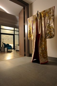 use one of my antique kimonos in front of the slate wall in the foyer?