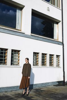 Hermès - Vestiaire d'Hiver 2014. Riding Skirt in tobacco wool gabardine, overshirt in bronze green double-face cashmere and wool, pump shoes in black smooth alligator and black calfskin #hermes #womenswear #fashion #hermesfemme