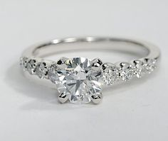 Unique engagement ring with a side stone pattern that you probably havent seen before! The side stones in this ring are graduated, which means that the outer side stones are smallest, and they get bigger as they come together at the center diamond. The band is 14k white gold and you can set almost any diamond size and shape in the center.
