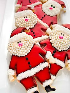 Edible pearls make a standout beard for these #Santa cookies. #Christmas #dessert