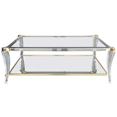Elegant Lucite And Glass Coffee Table | From a unique collection of antique and modern coffee and cocktail tables at https://www.1stdibs.com/furniture/tables/coffee-tables-cocktail-tables/