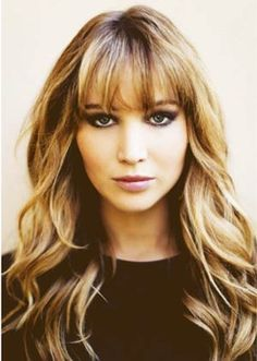 Wispy Thick Front Fringe with Wavy Long Hair. This could certainly suit a round face like mine.