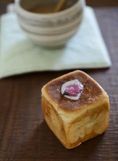 Japanese bread with salted cherry blossom and red beans inside