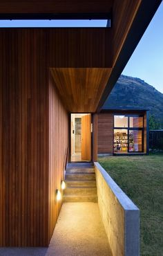 Drift Bay House By Kerr Ritchie Timber Boards Line The Walls Stone Wall And Staircase Wooden Door Family Lake Home: Family Lake house Nestled in Its spectacular Mountainscape