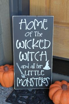 "Easy, cute style of the sign, perhaps instead with text: ""BEWARE: Home of a handsome devil, a wicked witch, and all their little monsters."" .. like to include the hubs :)"