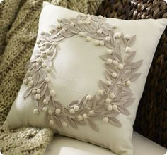 pottery barn jeweled wreath embroidered pillow  Use as tree skirt inspiration with green leaves on drop-cloth skirt.