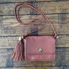 TOMMY HILFIGER Small Brown Satchel with Tassel! Great condition! Only worn a few times briefly! Inside is in perfect condition - minor scratches on front latch! Willing to accept reasonable offers! Tommy Hilfiger Bags Satchels