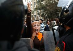 anti-government protester gestures during clashes wit' police in Cairo.