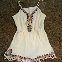 Indian style mini romper This cream red and navy blue romper is the in style in los angeles. Dress it up with some booties or flats and you will be in style. Only wore once Tea n Cup Other