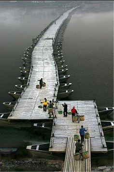 Wood Boat Bridge in Ganzhou, Jiangxi Province. Made of more than 100 wood boats, it has a history of over 800 years old.