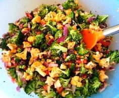 Broccoli and Walnut Salad Dressing: 1 Tbsp. raw sugar 1/3 cup red wine vinegar 1/2 cup extra virgin olive oil 1 tsp. red onion (finely chopped) 1 tsp. lemon juice 1/2 tsp. poppy seeds Whisk dressing ingredients thoroughly  Broccoli Walnut Salad Mix:  5-6 cups broccoli florets  chopped 1 medium head of cauliflower chopped 2 cups raisins 1 medium red pepper chopped 1-1/2 cups of red onion diced 1 cup walnuts