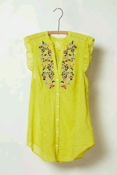 This top is really pretty. I like the flower detailing and the sleeves. The yellow is awesome too.