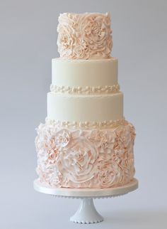 LOVE the Ruffle Rose details on the bottom and top tiers of this four-tier wedding cake! Probably White, Cream, or Ivory colored for me.