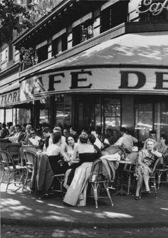 lesgrandsphotographes-deactivat:  Robert Capa. Café de Flore, place St Germain des Prés, Paris, 1952