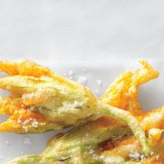 In Italy, fried zucchini blossoms are the jalapeño poppers of the jet set. Crunchy, salty, and utterly addictive, they go perfectly with an aperitivo, from a Bellini to a Negroni.