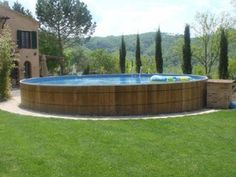 above ground pool-I like the wooden barrel look