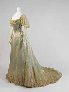 Evening dress  House of Worth  (French, 1858–1956)  Date: 1898–1900 Culture: French Medium: silk, cotton, metal Dimensions: Length (a): 17 in. (43.2 cm) Length at CF (b): 41 3/4 in. (106 cm) Credit Line: Gift of Miss Eva Drexel Dahlgren, 1976