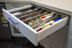 Utensil drawer with movable sections. www.thekitchendesigncentre.com.au @thekitchen_designcentre