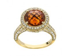 4.26 carat Round Brilliant Citrine set with 1.15 carat total weight round brilliant Diamonds in micro pave' setting, set in 18 karat yellow gold