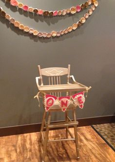 First Birthday Highchair. Bought an antique highchair off kijiji and spray painted it rustoleum's champagne mist. The ONE banner was a Pinterest inspiration. Accented with the rolled paper flower garland