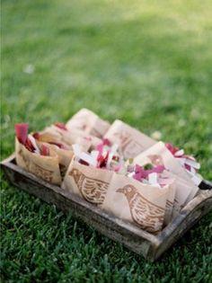 bio degradable petal confetti in stamped brown paper bags