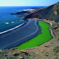 Colors of the Canaries, Lanzarote Island >>>A Spanish Isle off the coast of Africa w / a semi-crater that has created a dense and salty green lagoon.  #MediumMaria