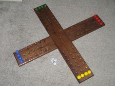 Huh?  4 person Walnut Aggravation board game. $75.00, via Etsy.