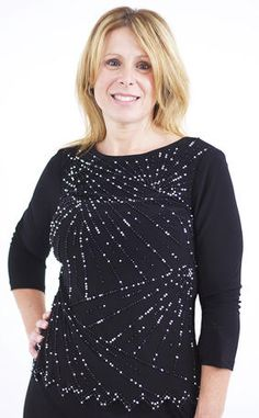 The beading on this three quarter sleeve top is amazing!