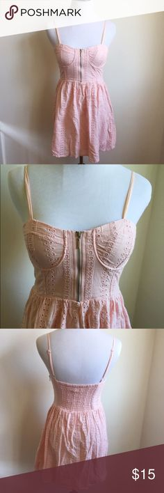 Blush Pink Eyelet Dress with Corset Style Top Pretty soft pink dress with flattering bust detail.  Exposed zipper in from and invisible side zipper.  Adjustable spaghetti straps.  Measurements available upon request.    💕💕Don't be shy, make an offer 💕💕 👍🏻👍🏻 Bundle and SAVE! 👍🏻👍🏻 🛍 15% off 3 or more items 🛍 🙅🏻🙅🏻 NO TRADES 🙅🏻🙅🏻 🚫🚫NO MODELING🚫🚫 Forever 21 Dresses Mini