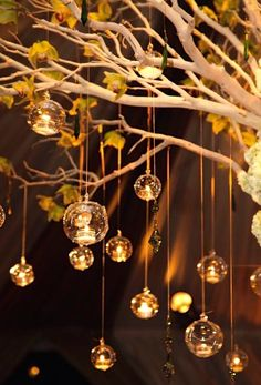 DIY IDEA: opulent centerpiece Manzanita tree with tea light filled hanging glass orbs from @wecanpackage. Link in profile. #diywedding #weddingideas