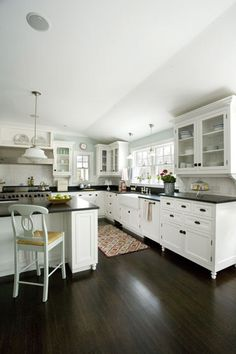 Our new kitchen should have a similar look. off white cabinets, dark quartz countertops, and dark wood floors. White Kitchen Cabinets, Kitchen Redo, New Kitchen, Glass Cabinets, Kitchen White, Dark Cabinets, Kitchen Ideas, Kitchen Layout, Kitchen Designs